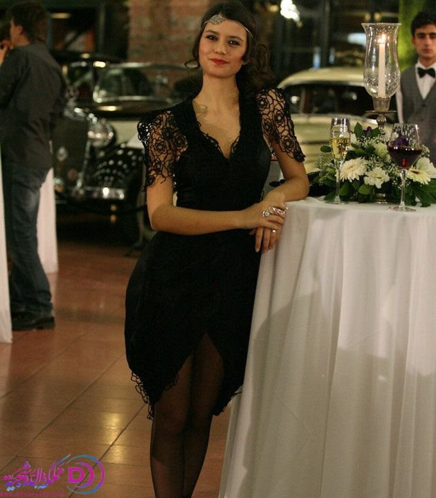 Beren Saat in black dress with mini skirt