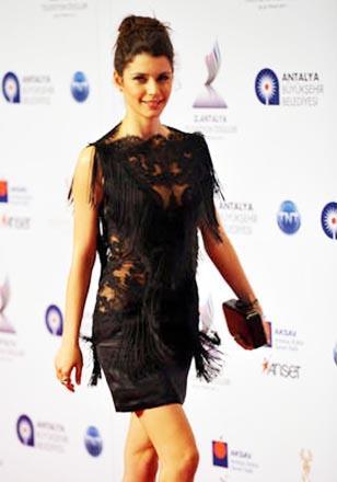 Beren Saat in black mini dress