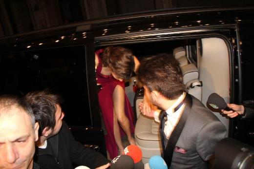 Beren Saat in her red dress with high slit