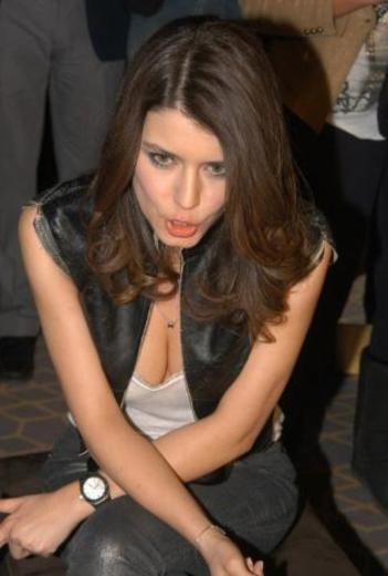 Beren saat with a cleavage.