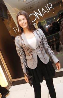 Beren Saat in black mini skirt