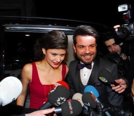 Beren Saat in her red dress with her boyfriend Kenan Doğulu