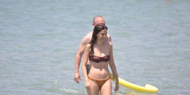 Bergüzar Korel has a fit body  and not afraid to wear bikini