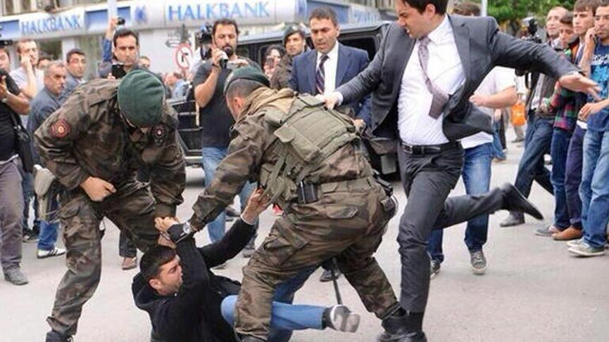 Erdoğan's aide Yusuf Yerkel is kicking a protestor