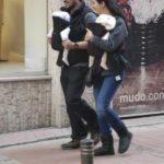 Tuba Büyüküstün and her husband Onur Saylak carrying their twin girls