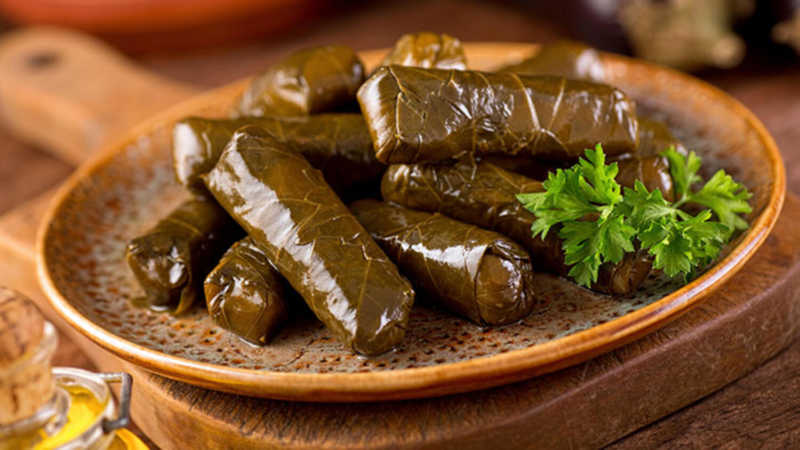 Dolma — Stuffed Grape Leafs is a delicious flavour of Turkish cuisine consists of grape leafs and rice inside.
