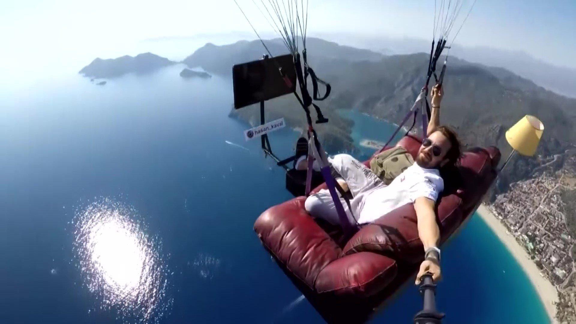 He also did paragliding on a sofa over Turkey's Ölüdeniz (Dead sea)